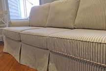 Cynthia's Ticking Stripe Slipcovers / I updated this outdated plaid sleeper sofa with a custom slipcover in classic ticking. The woven black and grey stripe is a great looking alternative to the more traditional indigo and natural ticking. A beautiful look for a Lake Michigan beach home.