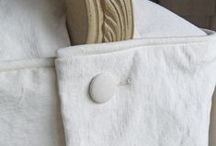 Jane's Natural Canvas Slipcovers / This pair of French-style chairs went from formal to casual-lakeside-living thanks to washed canvas slipcovers. Understated styling in natural cotton/poly canvas with low wrinkle. So inviting!
