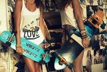 Girls & Longboards Skateboards / Any girl can ride a board and they don't have to wear fashion, all cloths will do as long as you have fun doing it.  A collection of Longboard Skateboard and girls with them.