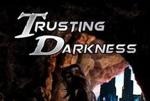 "TRUSTING DARKNESS - English novel / From the novel: ""She had decided to close her love in a box, to hold it captive while waiting for a better moment to set it free… but she had never stopped feeding it. It had outgrown its prison and it had escaped at the first chance, blowing up in her face with all the power of a time bomb set on the wrong timer."" USA ➩ http://goo.gl/co2aGx UK ➩ http://goo.gl/2fxH27 €U ➩ http://goo.gl/VgmEQZ"