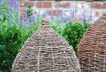Bee Skeps / A decorative garden item, conical in shape, usually made from braided straw. Once used to keep bees, they were discarded when hives that could be opened to harvest honey or care for the bees were developed, as the skep had to be destroyed to gather the honey. www.apidaecandles.de