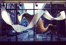 Projects - Window display / Our hand-folded window display designed by 'London's Queen of Origami' Kyla McCallum. There are two pleating patterns, each with 8514 lines... Which in total is 17,028 lines folded by hand! - You can see this in our DESSO London Showroom.