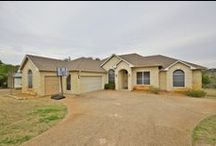 New Listing in Dripping Springs, TX - Offered at $369,900 / Gorgeous home on 1.3 acre lot! Home features open spacious floor plan, 3 car garage, fireplace, rounded corners, formal dining, covered patio, and so much more! Galley style kitchen features skylight, recessed lighting, and walk-in pantry. Large master boasts huge full bath with garden tub, separate shower, separate vanities, and skylight.  Backyard features covered patio with fans and beautiful hill country views and private garden, great for entertaining.  Perfect quiet country living!