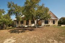 New Listing in Dripping Springs, TX on 15 Acres - Offered at $480,000 / Lovely spacious home on 15.5 acres! This is a 1.5 story home. Home  features stained concrete flooring, recessed lighting, hardwood floors, French doors, 3 car garage, and more! Kitchen boasts center island, breakfast bar, and stainless steel appliances. Large master features full bath with separate double vanity, garden tub, separate shower, and walk-in closet. Backyard features screened in porch, extended patio, and beautiful hill country views.