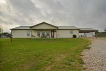 New Listing in Bastrop County - Offered at $325,000 / Perfect country-living home! Home sits on 10.4 acres and features recessed lighting, open floorplan, large master, ceiling fan in every room, and more! Kitchen/dining combo features tons of storage space and custom cabinets. Master boasts full bath with jetted tub. Large additional rooms! Property includes barn, garden, huge extended covered patio, and fencing for livestock. This is the perfect quiet country home!