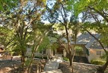 New Listing in Austin's Westlake Hills - Offered at $950,000 / Beautiful private oasis minutes from downtown in Eanes ISD on 1.4 acres! Home features stone fireplace in family room, high & coffered/vaulted ceilings & extra living area. Gourmet kitchen boasts granite counters, center island, breakfast area & stunning cabinetry. Master features double vanity, garden tub, separate shower & walk-in closet. Two unbelievable covered back decks with breathtaking views, perfect for entertaining.