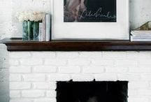 white brick fireplace and mantel decor