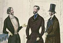 """Oděv """"Biedermeier"""" / -styl měšťanské módy 1815-1848 -životní styl střední vrstvy -název vznikl až v roce 1855, kdy se v časopise objevila karikatura měšťana, kterého nazvali Gotlieb Biedermeyer"""