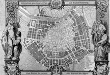 Urbanismus / -rozrůstaní měst,bourání hradeb -např. Ringstraße, Víden - nové budovy,muzea,parky -Pařížské bulváry -Barcelona má být šachovitě členěna, né centrálně,ale na rozdílné okruhy -číslování ulic v New Yorku -budování Washingtonu -návrh lineárních měst - propojení dvou center linii s obytnými domy a železnicí -myšlenka satelitních měst (Anglie)