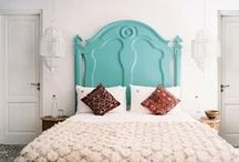 Bedroom colors and style / Picture This! Bed with a canopy.  Fabric draped over canopy. On wall behind the bed - an old door or wooden slats with pom pom decor. Large dresser. Wire, flowers and leaves, and a mirror mounted above the dresser.  Dark brown frames...sea green and teal accents.  Walls painted tan to match the bedspread... / by Emily Depue Bennett