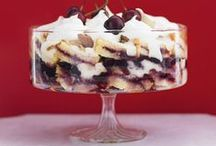 "Food - Nothing to Trifle Over! / Trifle is an English dessert dish made from thick custard, fruit, sponge cake (often soaked in sherry or other fortified wine), fruit juice or jelly (gelatin in American English), & whipped cream. These ingredients are usually arranged in layers. The earliest use of the name trifle was for a thick cream flavoured with sugar, ginger & rosewater, the recipe for which was published in England, 1596, in a book called ""The good huswife's Jewell"" by Thomas Dawson.  / by Bruce D. Bryant"