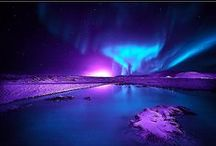 Aurora / An aurora, sometimes referred to as a polar light, is a natural light display in the sky, predominantly seen in the high latitude (Arctic and Antarctic) regions. Auroras are produced when the magnetosphere is sufficiently disturbed by the solar wind that the trajectories of charged particles in both solar wind and magnetospheric plasma, mainly in the form of electrons and protons, precipitate them into the upper atmosphere (thermosphere/exosphere), where their energy is lost.