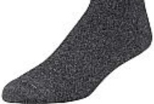 Merino Wool Socks / Merino wool is a natural fiber that offers a lot of benefits. Because of this, it is often used as main material for socks.  Merino wool socks can regulate temperature, making them great for different weather conditions. Socks made of this material will keep your feet warm during cold weather by trapping your body heat in its fibers.  Because it is breathable, merino wool socks also help prevent the growth of bacteria, which is the main cause of problems like athlete's foot.