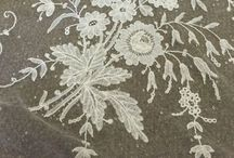 """Brussels lace / Brussels lace is a type of pillow lace that originated in and around Brussels. The term """"Brussels lace"""" has been broadly used for any lace from Brussels; however, the term strictly interpreted refers to bobbin lace, in which the pattern is made first, then the ground, or réseau, added, also using bobbin lace."""