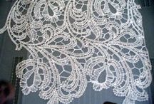 Schneeberg lace / Schneeberg lace is a bobbin tape lace. The tape is made with bobbins at the same time as the rest of the lace, curving back on itself, and joined using a crochet hook.
