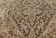 Milanese lace / Milanese lace, lace made at Milan in the 17th and 18th centuries. It is a bobbin-made lace, with a design consisting of bold, conventionalized leaf, scroll, and ribbon ornament interspersed with arms, human and animal figures, and the like.