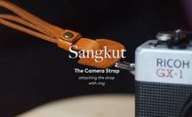 Sangkut, The Camera Strap / Noesa camera strap is perfect for any photographer ethusiast. Made from natural dyed ikat weaving from Flores, Indonesia and genuine leather. The strap hangs at roughly belly-button length and connects to any camera accepting a strap. Noesa camera strap provide the ultimate in comfort as well as strength and durability. Noesa camera strap will make you more stylish in every photo shoot.