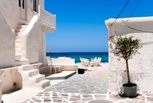 Experience Paros / The best kept secret of the Cyclades, the island of Paros boasts spectacular sandy beaches, stunning sunsets, soaring windmills, picturesque villages with whitewashed churches and winding cobblestone alleys, catering for the most discerning travellers.