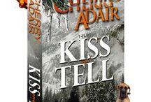 KISS AND TELL / Marnie Wright isn't looking for adventure, but Mountain man Jake Dolan invades a peaceful day of soul-searching and pulls a gun on her.  Stashed in his secret lair--an underground techno-fantasy complete with security monitors and an arsenal-- Marnie realizes the guy is military, top secret military.  He's also got the most beautiful mouth she's ever seen. Too bad he could get her killed.