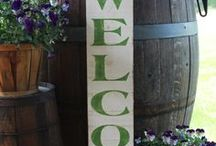 WELCOME / We have made many of these signs over the years.  We have used several different types of wood, and many different paint color combos.  But our rustic wood with black letters is the most popular with customers. Contact us through our Etsy store if you want a custom color option!