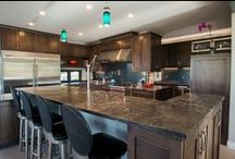 Arvada West 73rd Place / Integrating spaces made a separate Butlers and Kitchen into an extra large functional space with a large island and chef-sized appliances. Designers: Jared Caruso and Mark Fergenbaum