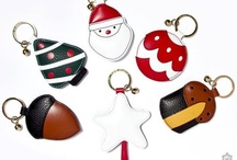 """Pineider Christmas keyrings / The Pineider Christmas keyrings are made from smooth full flower calfskin and fine grained calfskin. On the back you can find, blind embossed """"Pineider, made in Italy with love"""" and, attached to the ring, a small bell. It comes with its """"Pineider made in Italy with love"""" box."""