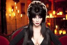 Elvira, Mistress of the Dark / Cassandra Peterson Stars as Elvira -- also known as The Vamp of Camp, The Sassy Lassie with the Classy Chassis, The Gal with the Shape that Drives Men Ape, The Queen of the B's, Who's Always Ready to Please. If you're looking for an Elvira costume, there are plenty of ideas here. Of course, if you just want to gaze at photos of everyone's favorite Mistress of the Dark, we've got those too. Unpleasant dreams, darlings! https://halloweenfunshoppe.com/elvira-loves-halloween/