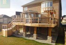 Dual Level Cedar Deck with Wrought Iron Railings, Pergola and Stone Walkout Basement