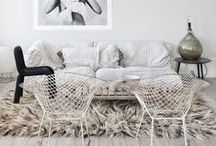 HOME   living rooms / Great Scandinavian interiors.  Characterized in lots of white, pale tones, wood, wool and graphical prints.