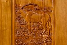 Wood. Working as art. / Handcrafted and hand carved solid genuine mahogany wood doors.  Functional fine art.