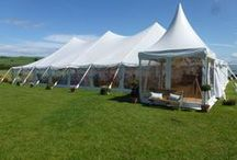Wedding Marquee / Marquee Hire for weddings. Beautifully elegant wedding marquees, with flowing peaked roofs, fully panoramic clear walls, ivory linings & hardwood floors.