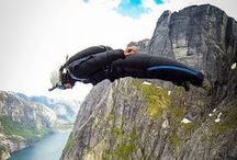 BASE Jumping / People jumping from building, antenna, span or Earth either with or without wingsuit.