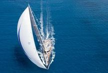 Sails / Sailing for sport or for pleasure.