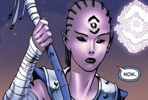 Indigo-1 | Iroque / Iroque aka Indigo is the leader of the Indigo Tribe of compassion. Indigo and her tribe speak a language that is unknown even to the Green Lantern Ring, which is supposed to be a universal translator for every language in the universe. Iroque and her tribe each possess a power staff, and power ring, which allow them to utilize many powers of the Indigo Tribe. These powers include the ability to fire energy blasts, create constructs, teleportation, and flight. #DC comics