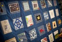 Holocaust Quilt of Memories / In 2007, Mount Sinai Memorial Parks and Mortuaries invited people to submit squares that commemorated or spoke to the Holocaust in any way they wanted.    Instead of receiving enough squares to create one quilt, we wound up with enough hand-crafted squares to create three quilts.  Each square is unique. Each one tells a story of tragedy and hope.