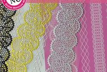 NailCandi Lace Stickers / Embossed lace creates elegant nail art in a matter of seconds.  Lace Stickers have a <0.5-0.7mm Thicknesss. There are 6 designs available and each design is available in black, white, gold and silver.