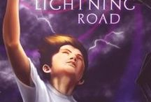 Joshua and the Lightning Road (Month9Books 2015) / Twelve-year-old Joshua Cooper learns the hard way that lightning never strikes by chance when a bolt strikes his house and whisks away his best friend—possibly forever. To get him back, Joshua must travel the Lightning Road to a dark world where stolen human kids are work slaves. New friends come to Joshua's aid and while battling beasts and bandits and fending off the Child Collector, Joshua's mission quickly becomes more than a search for his friend—it becomes the battle of his life.