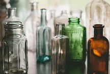 Glass bottles, jars and cloches