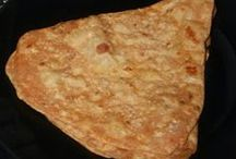 Rotis, Parathas and Pooris /  An Indian bread that is made from stoneground flour.