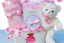 """Girl's Baby Gift Baskets / Our """"One of a Kind"""" unique baby girl gift baskets make the perfect celebration gift especially when you have your basket personalized. These gift baskets are designed with a theme with so much love and perfect to send to welcome the new baby girl into the family."""
