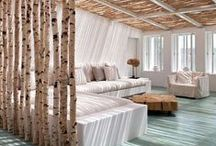 Primitive Style / Twigs, Branches, Logs, Pebbles, Stones, Antlers, Horns, Animal Hides, Sheep Skins. Elements of this style are often added to a clean, neutral contemporary/modern design with great effect.