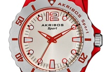 "Akribos XXIV / Akribos XXIV's steampunk-meets-Madison Avenue watches exude industrial chic. Based in Brooklyn, the company celebrates the origins of timekeeping not only through its wares, but also through its name. Akribos, the Greek word for ""precise,"" honors the ancient Greeks' efforts to accurately track time as part of their study of astronomy, while XXIV is the Roman number for 24 — the number of hours in a day."