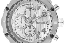 "Lancaster Italy / LANCASTER WATCHES HAVE FOR SEVERAL YEARS REPRESENTED ALMOST 75% OF THE TOTAL TURNOVER, AND RESULTS ARCHIVED HAVE ENABLED THE BRAND NAME TO BECOME ON OF THE MOST PRESTIGIOUS IN THE CONTEXT OF ""Made in Italy"" PRODUCTS"