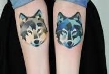 wolf tattoo / I'm considering getting a wolf tattooed so, this is just a few designs I saw on the Internet and actually liked