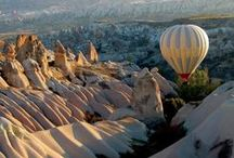 Cappadocia / Cappadocian region is the place where nature and history come together most beautifully within the world. While geographic events are forming Peribacalari (fairy chimneys), during the historical period, humans had carried the signs of thousand years old civilizations with carving houses and churches within these earth pillars and decorating them with frisks.