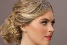 GS Bridal: the Jasmine - Beachy / A bachy bride.  First look: Natural waves pulled into an ethereal braided updo. Second look: A cascade of half-up, half-down tousled waves, accented with a halo of braids. Makeup for both looks: Fresh, sun-kissed and golden eyes with a pop of coral on the lips.