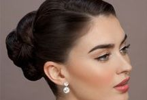 GS Bridal: the Rose - Classic / Classic, Timeless Bride.  2 styles. First look:  A silky, smooth polished and secure classic updo.  Second look: A touch of volume at the front, pulled back into a simple and elegant chignon.  Makeup for both looks: Classic neutral hues on the eyes with a feminine rose lip and cheek.