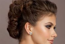 GS Bridal: the Violet - Trendy/Modern / Modern. eye-catching, trend-based. First look: A modern and exquisite updo with height and intricate detail. Second look: Soft, voluminous waves swept with head-turning movement and bounce. Makeup for both looks: Sultry violet smokey eyes paired with a trendy nude lip and contoured cheeks.