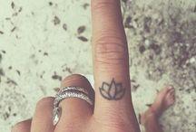 Finger Tattoo Ideas / LH-lotus on pointer, double heart infinity on ring finger. RH- maple leaf, gemini symbol,