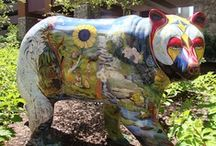 Painted Bears / The town of Cherokee is being overrun by a collection of bears. But, don't worry­ these bears are completely harmless. Several Eastern Band of Cherokee artists have created a series of large, life-like fiberglass bears and painted them in bright vibrant colors and designs.